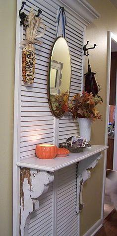 Add a shelf to shutter doors for a display center!