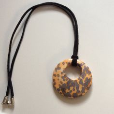 Synthetic River Stone pendant on a black suede Necklace offered by HappyLilac! Happylilac.etsy.com