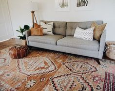 Gray midcentury modern couch with vintage moroccan area rug, boho textiles Living Room Decor Grey Couch, Grey Couch Decor, Living Room Area Rugs, Chic Living Room, Living Room Lighting, My New Room, Living Room Modern, Rugs In Living Room, Living Room Designs
