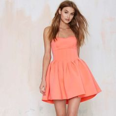 NWT Nasty Gal Strapless Coral Dress Brand New w/ Tags! Nasty Gal strapless pinky, coral dress. Features pleating detail, strapless silhouette and top stitching. Great dress for spring and summer! Size XXS Nasty Gal Dresses Strapless