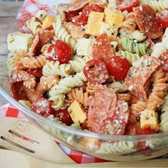 This Pepperoni Pizza Pasta Salad features tri colored rotini pasta with pepperoni, mozzarella, cheddar, and tomatoes in a Parmesan vinaigrette. This Italian pasta salad variation is the perfect summer side dish recipe! Play the new video below to see how to make my Pepperoni Pizza Pasta Salad recipe in action – it's so easy! There's... Read More