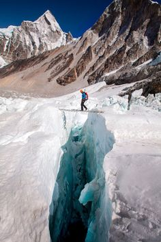 Dispatch #6: Email From Cory (iPad Exclusive)  POSTED APRIL 19, 2012  Conrad Anker crosses a ladder in the Khumbu Icefall.