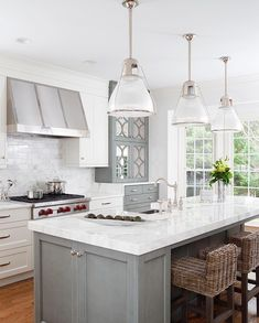To improve the interior of your home, you may want to consider doing a kitchen remodeling project. This is the room in your home where the family tends to spend the most time together. If you have not upgraded your kitchen since you purchased the home,. Grey Kitchen Island, Gray And White Kitchen, Grey Kitchen Cabinets, Kitchen Cabinet Design, Gray Island, Island Hood, Kitchen Counters, Countertops, Living Room Kitchen