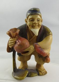 "Antique Japanese hand-carved polychrome ivory Netsuke, depicting old man holding bag. 2 1/4"" high."