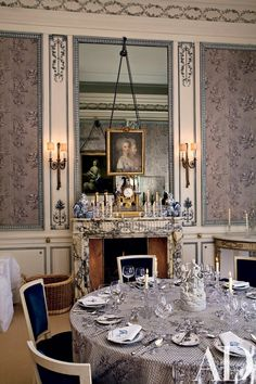 The décor and ambience of the dining room reflect Menotti's gift for evoking a festive atmosphere. Against the mirror, he layered delftware and other ceramics, an ornate mantel clock and a late-18th-century French double portrait previously held in the royal collections at Wiesbaden, Germany.