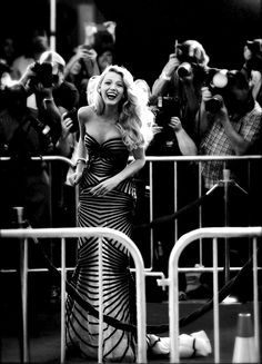 Blake Lively looks stunning with her big retro waves and Art Deco inspired black dress. Lovely.