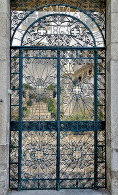 wrought iron Lar de Santa Estefania by Cat Man! door