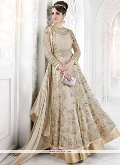 Add a adolescent burst of colour with your wardrobe with this beige net floor length anarkali suit. The embroidered, patch border, resham and zari work appears chic and excellent for wedding. Comes wi...