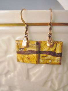 Here we have a set of matched stone earrings! Landscape Jasper squares were used to create this pair of earrings. Adds a chic and elegant