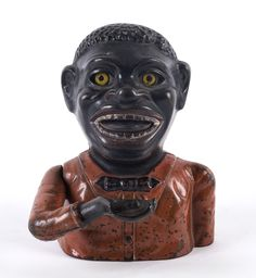 """An American """"Jolly Nigger Bank"""" painted cast iron money box by J. & E. Stevens Co. Cromwell Conn. U.S.A. 18cm… / MAD on Collections - Browse and find over 10,000 categories of collectables from around the world - antiques, stamps, coins, memorabilia, art, bottles, jewellery, furniture, medals, toys and more at madoncollections.com. Free to view - Free to Register - Visit today. #MoneyBanks #MADonCollections #MADonC"""