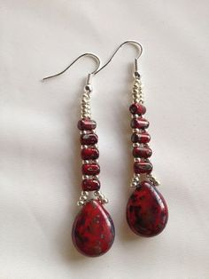Picasso Red Beaded Earrings on Etsy, $25.00- Oooo~ I like the use of those seed and slider beads!