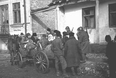 Romanian soldiers supervise the deportation of Jews from Kishinev. Kishinev, Bessarabia, Romania, October 28, 1941.