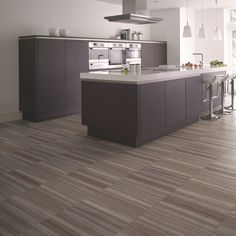 When it comes to luxury vinyl flooring, we have a range of options that will be perfect for your home. Discover our luxury vinyl flooring selection today at Amtico. Best Flooring For Kitchen, Vinyl Flooring Kitchen, Unique Flooring, Luxury Vinyl Flooring, Luxury Vinyl Tile, Flooring Ideas, Ceramic Flooring, Black And White Backsplash, Amtico Flooring
