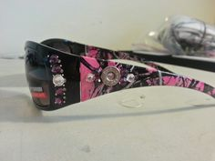 Black marlin 2 muddy girl camo with a 38 caliber bullet completed in amethyst and crystal