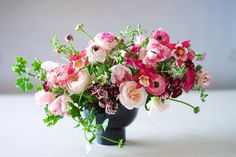 pink geranium, columbine, rose, tulip, oregano and ranunculus arrangement by Tulipina