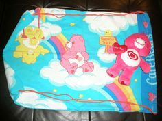 Care Bears back. Bags for foster kids made from pillowcases and stuffed with a furry friend.