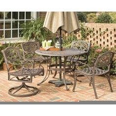 5 Piece Outdoor Dining Set by Home Styles. $1199.09. 5555-3285 Features: -Five piece outdoor round dining set.-With its intricately designed metal work it will certainly become the focal point of the deck or patio.-Durable, lasting year after year.-Nylon glides on all table and chair legs.-Attractively patterned table top has center opening to accommodate umbrella.-Maintenance free. Includes: -Set includes one 48'' round dining table, two swivel chairs and two arm chairs. Constru...