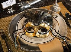 Put on the glitz with mysterious masks and dramatic decor inspiration!