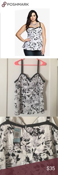 Black, White &Gray Floral Peplum Top Black, white, and gray peplum floral top with a half zip up back, this gorgeous top is perfect for spring and can be worn on several different occasions! torrid Tops Tank Tops