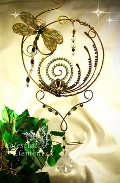Handmade sun catcher copper wire was bent by CelestialElementsNM