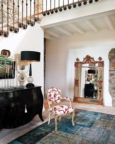 Spanish country house. Love the stair rail and the patchwork Persian rug.