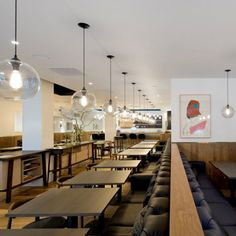 The open-plan Pollen Street Social restaurant bridges together two previously separate buildings, spread out across the ground floor and basement. Back-to-back banquette seating by Neri & Hu