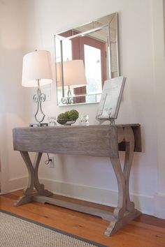 I love the rustic finish and narrowness of this entry table... takes up so little room.