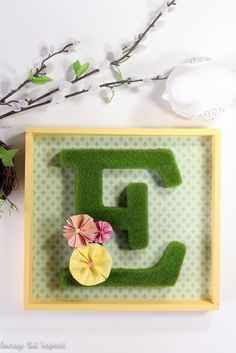 A moss monogram shadow box is a perfect way to welcome spring to your home! Click through to get the full supply list and tutorial to make your own!