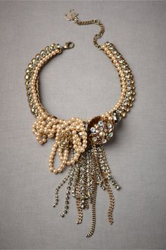 Swell-Of-Radiance Necklace  Luxuriantly looped and knotted strands of crystals, pearls, and beads tumble down from a luminous, flower-embellished collar.