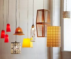 Repurposed Container Pendant Lights.  These are amazing!  Made from thrift store finds:  plastic cups, kitchen utensil holder, a shapely water bottle, a small wastebasket, and a hat :)