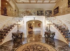 The lavish stone entrance complete with a double staircase certainly makes a first impression.