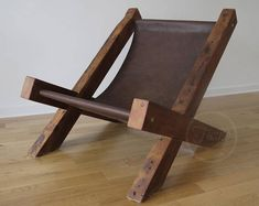 This comfortable chair is creative balance of rustic charm and modern style. It is made from the century-old reclaimed wood. Leather is classic glazed cow hide. via Reclaimed Wood and Leather Lounge Chair by TicinoDesign on Etsy. Reclaimed Wood Dining Table, Reclaimed Wood Furniture, Rustic Furniture, Cool Furniture, Modern Furniture, Furniture Chairs, Handmade Furniture, Furniture Design, Brown Leather Chairs