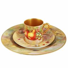 Royal Worcester Fruit Cup Saucer & Plate   An early 20th century Royal Worcester fruit decorated cup, saucer and plate.  The cup or can is decorated with fruit, has a gold interior and handle and is signed E Townsend (Edward).  The saucer is also decorated with fruit, has a gold centre and is signed H Price (Horace).  The plate is fruit decorated and signed H Everett (Hilda?).  All the pieces are marked Royal Worcester on the underside and all three pieces are in good condition. (Circa 1924-25)  Antique Pottery, Antique Art, Fruit Cups, Gold Interior, Objet D'art, Worcester, Cup And Saucer, Tea Cups, Unique Gifts