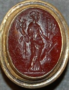Sard gem engraved with a draped Fortuna holding a cornucopia, ears of corn and a steering-oar.
