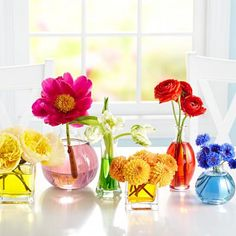 Use a box of food coloring to add playful punch to an array of bud vases. Here's how: http://www.midwestliving.com/homes/seasonal-decorating/50-bright-and-easy-spring-decorating-ideas/?page=1