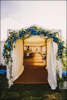 We love this flower archway at the entrance to this wedding marquee