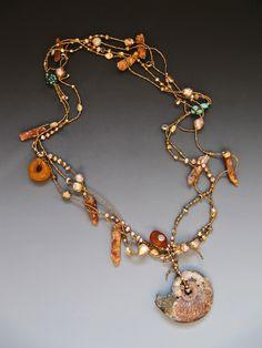 Ammonite fossil pendant, orange kyanite, antique Tibetan turquoise, antique Orissa bronze, fresh water pearls LuciaAntonelli.com
