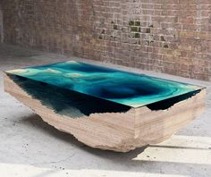 The Abyss Table by Christopher Duffy - Architect Magazine (FSC certified wood layers topped with sculpted acrylic glass to create an underwater topographic map)