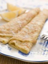 English Pancakes !!  1 cup flour,2 eggs,pinch salt,2 1/2 cups milk.Make a well in middle of flour.Break eggs into well Gradually stir in flour adding 1/2 of the milk.Beat for 5 mins then stir in remainder of milk.Let stand.Heat frying pan on burner spray with olive oil thoroughly!.When smokin' hot pour in enough batter to cover pan.Cook over medium flame until golden brown.Flip pancake :). Serve with brown sugar and lemon juice or powder sugar !!  Yummy Yum Yum ....