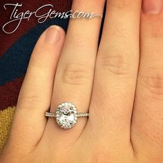 """Absolutely love this ring!! Already have gotten compliments on how it sparkles and shines."" 💖Thank you to my client for this review and photo of her 1.5 ctw oval halo ring.  Follow @tigergemstones  Shop now at 💍✨ TigerGems.com"