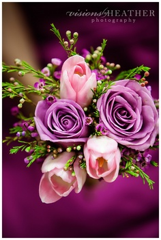 Rose and tulip wedding bouquet.  Purple roses and tulips perfect for wedding.  Use as bride bouquet or bridesmaid bouquet.  Great match with wine colored dresses! #weddingbouquets #bouquet #purple #rose #tulip #wedding