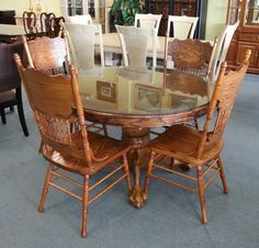 Item # 21255-14 Medium Stained Oak Pedestal Table w/ Protective Glass Top & 4 Chairs - $300