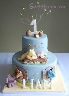 Simply adorable custom cake for a boy's 1st birthday. Love this for a Winnie the Pooh themed birthday party!