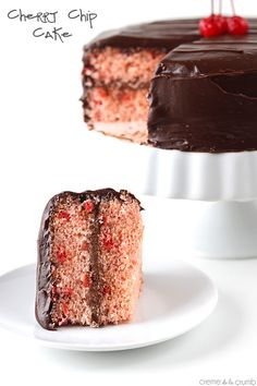 A moist homemade cherry chip cake with a hint of almond, whipped ganache filling, and a dark chocolate ganache frosting!