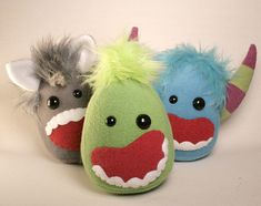 Cute idea for monster plushies. I really like how 2 different sized eyes are used. Pic only.