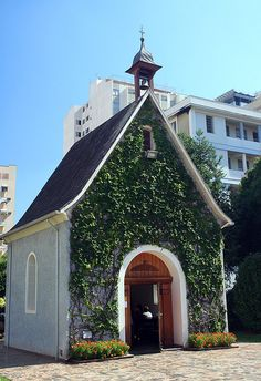 "This tiny chapel in downtown Londrina is one of more than 160 replicas of the original shrine in Schönstatt, Germany. The sign says ""Santuário de Graças da Mãe Rainha e Vencedora Três Vezes Admirável de Schönstatt"" (Shrine of grace and pilgrimage dedicated to Our Lady, Mother Thrice Admirable, Queen and Victress of Schoenstatt)"