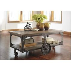 T500-721 Ashley Furniture Vennilux - Multi Rectangular Cocktail Table