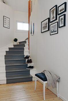 Stairs painted grey runner.