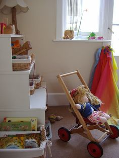an idea from this waldorf inspired room - these shelves are great for children of different ages. use the high shelves for toys for older children, out of reach for younger ones