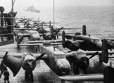 Doolittle planes on deck. American bombers rest on the flight deck of the USS Hornet, approaching the spot where the planes were launched on their raid on Tokyo, April Escort ship in left background. Yokohama, Nagoya, Gi Joe, Minneapolis, Doolittle Raid, Uss Hornet, Navy Aircraft Carrier, Pilot, Flight Deck